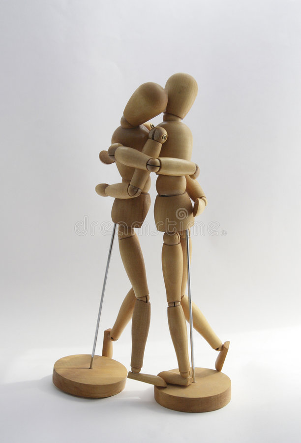 Wooden couple 2. Tenderness stock images