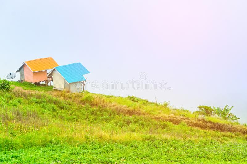 Wooden couple cottage in the top of the misty mountain stock photo