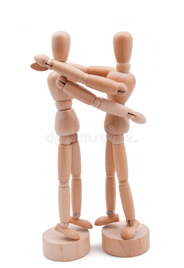 Wooden couple embrace royalty free stock photo