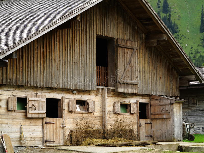 Cow barn dirty facade. A barn building with spatters of mud on the wall. Picture taken in the Alpine region of Austria stock image