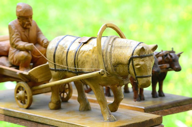 Wooden crafts, cart with a horse, handmade stock photo