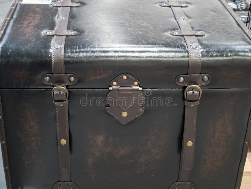 Wooden crate covered with leather. Decorative home interior. use for pirate treasure chest stock photo