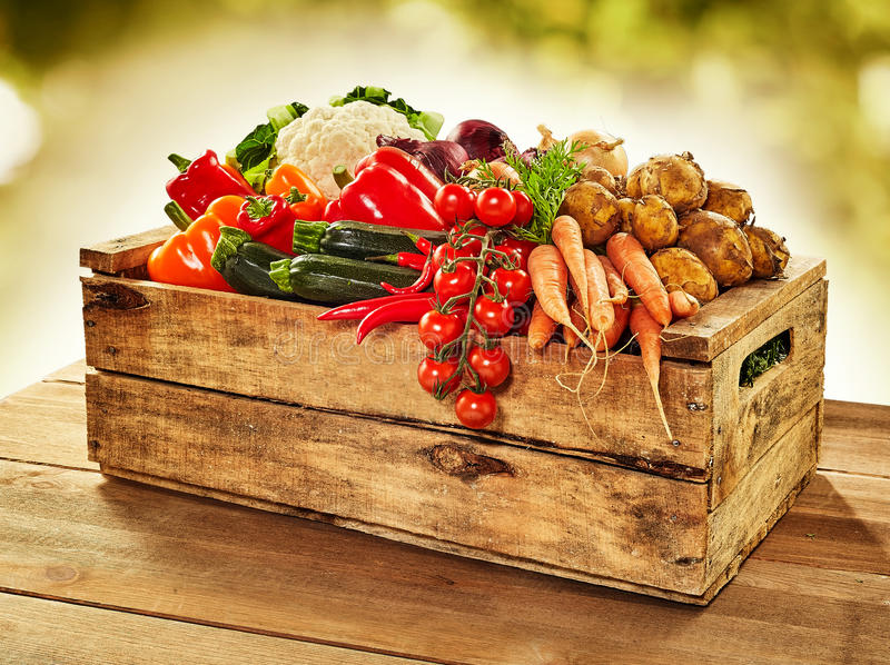 Wooden crate filled with farm fresh vegetables royalty free stock image