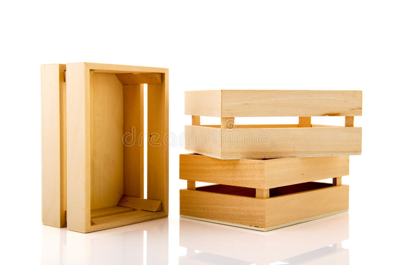 Wooden crates. Empty wooden crates stacked and isolated over white background royalty free stock photography