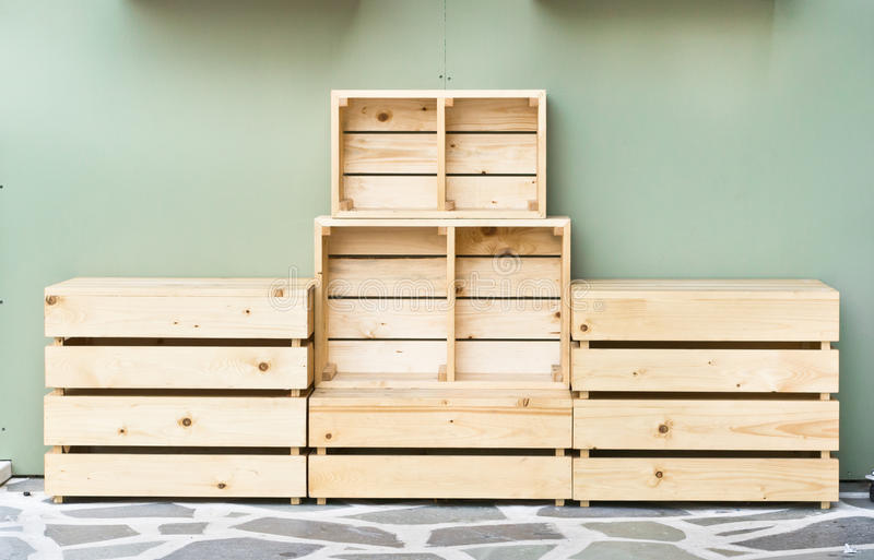 Wooden crates. Neatly stacked wooden crates against a wall royalty free stock photo