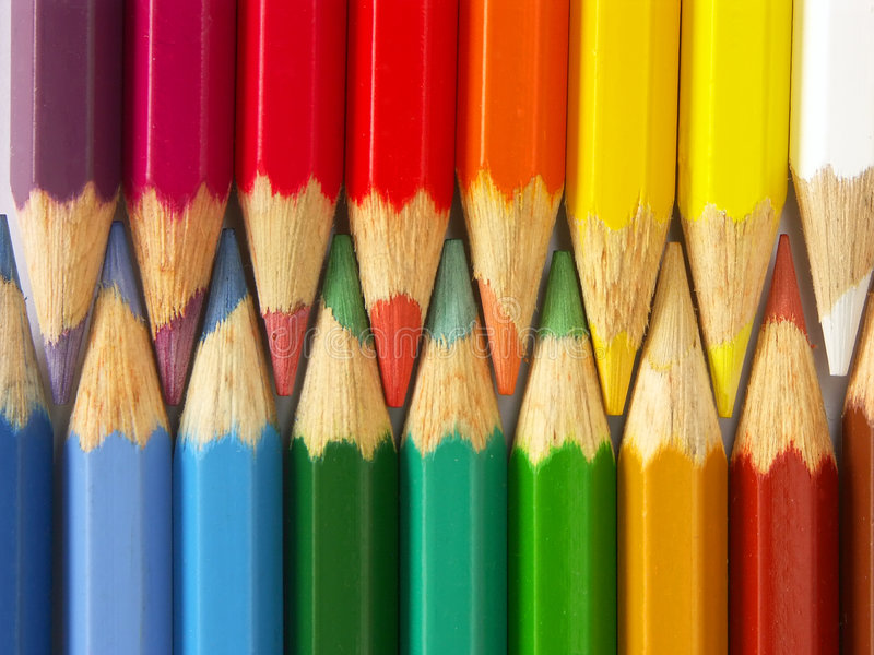 Wooden crayons. Two rows of colorful wooden crayons stock photo