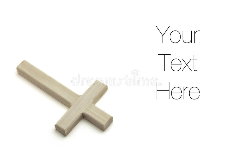Wooden Cross. Isolated on white background, copy space royalty free stock photo