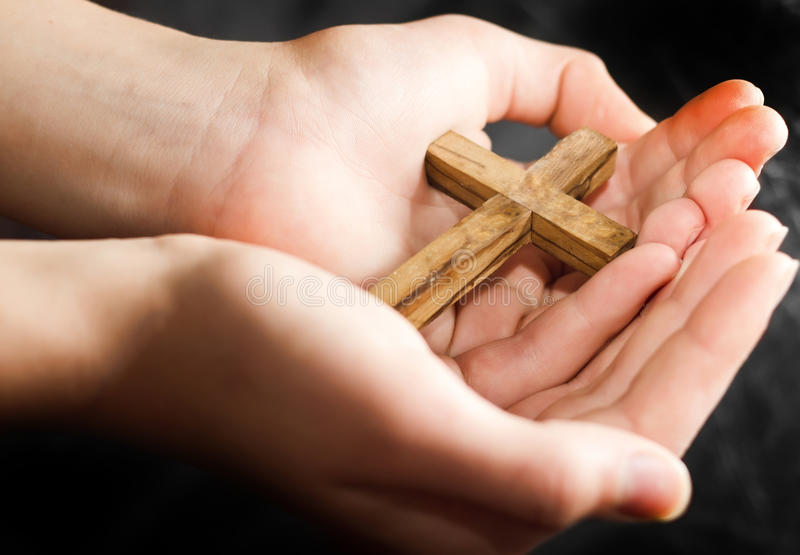 Wooden cross. In the hands royalty free stock images