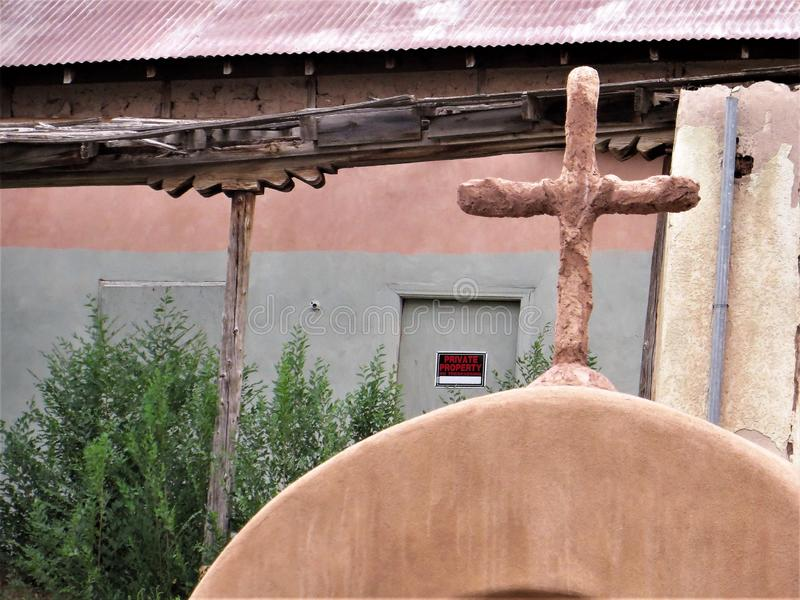 Cross on church in Chimayo, New Mexico royalty free stock photos