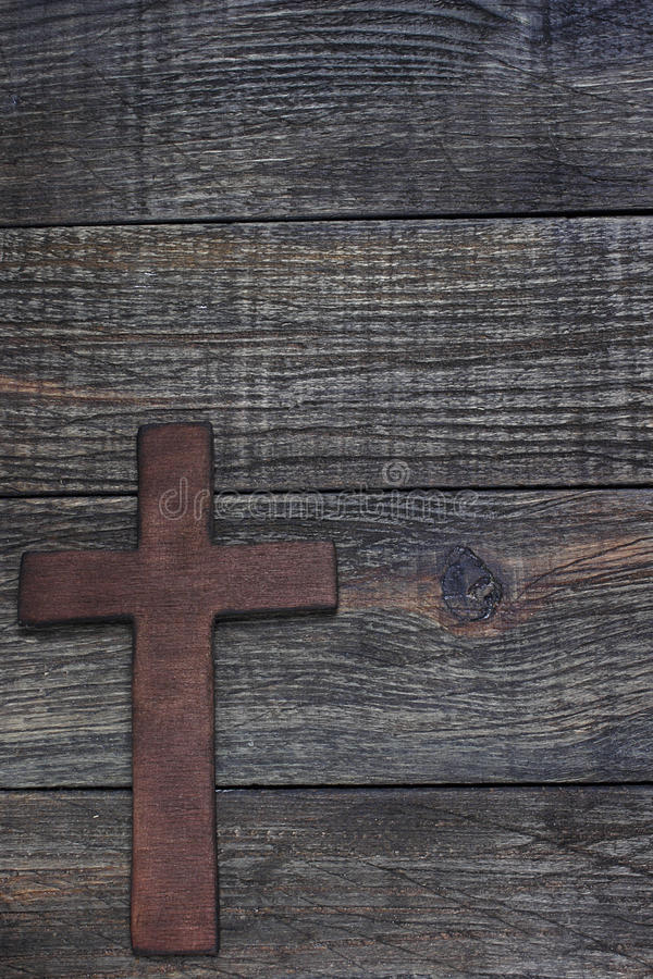 Wooden cross. On wooden background stock photo