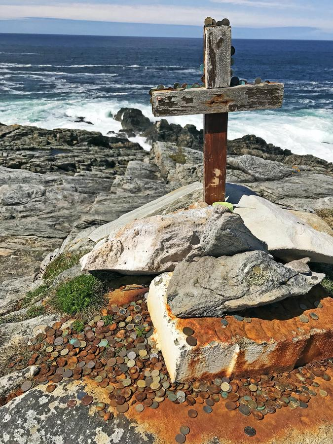 Wooden Cross and coins at Malin Head Donegal Ireland royalty free stock images