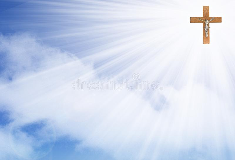 Crucifix in the rays of light stock photography