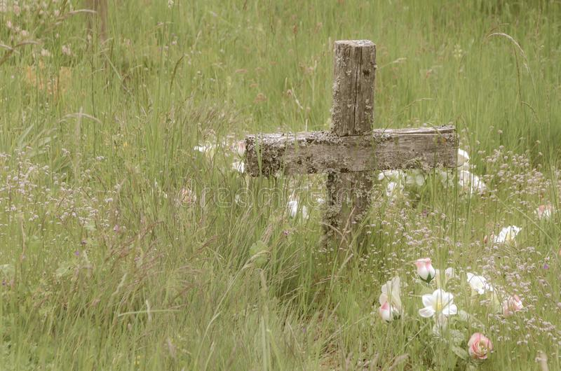 Wooden cross among the grass. Crosses, poor, cemetery, village, day, saints, november, 1, all, graves, dead, holiday, tribute, memory, nostalgia, longing royalty free stock images