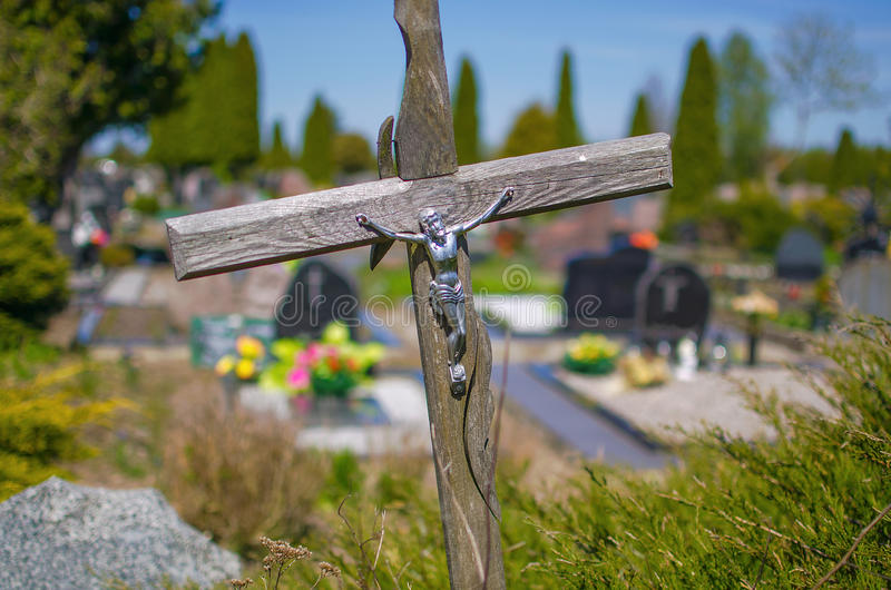 Wooden cross on a grave in a cemetery stock image