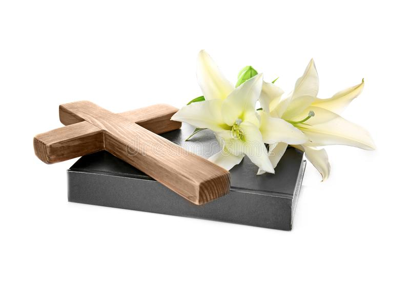 Wooden cross, Holy Bible and lily. On white background stock photo