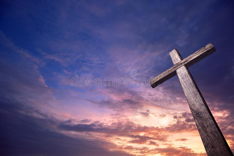 Wooden cross illuminated from the sky royalty free stock images