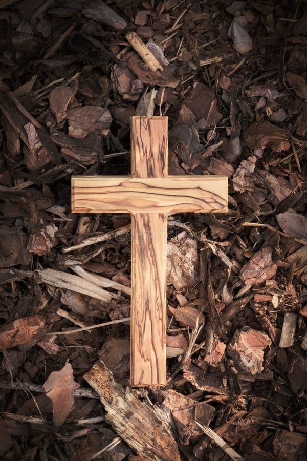 Wooden cross on dark wooden ground. Wooden cross lying on dark wooden ground royalty free stock photos