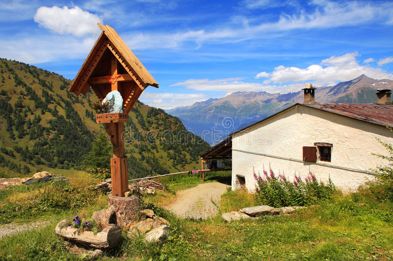 Download Wooden Cross Near Rural House In Alps. Stock Image - Image: 19968823