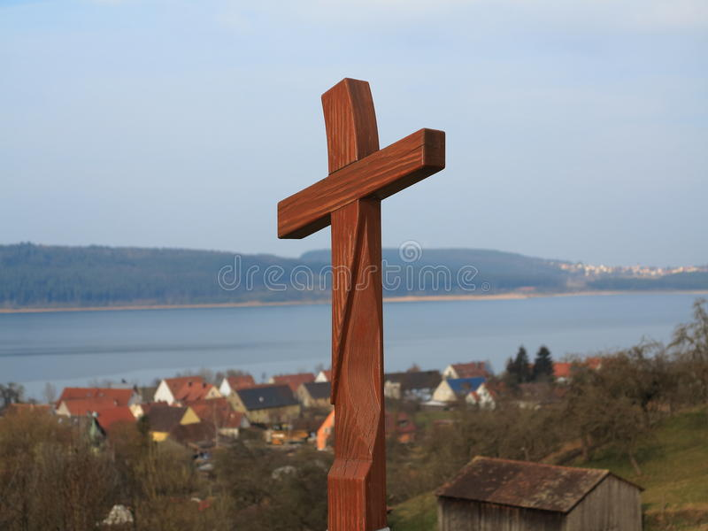 Wooden cross at pilgrimage route scenery. Cross on the hill of the pilgrimage route WAY OF ST. JAMES. A landmark at Lake Brombachsee, Franconia, Germany royalty free stock photography