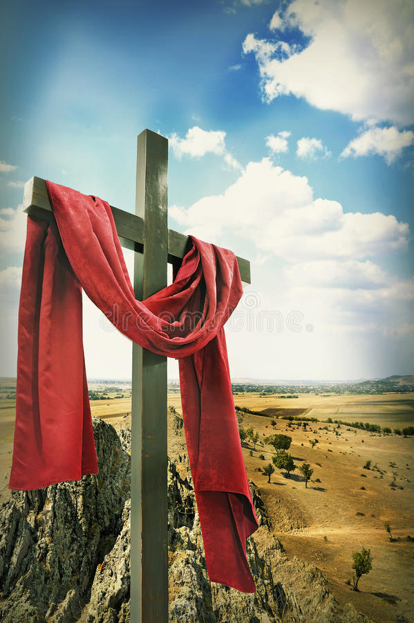 Wooden Cross with Red Cloth. On moun tain stock images