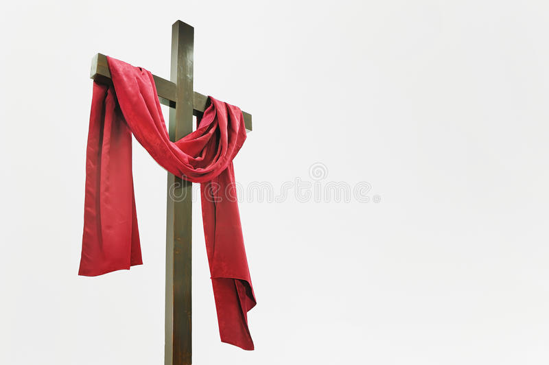Wooden Cross with Red Cloth. Isolated on white royalty free stock images