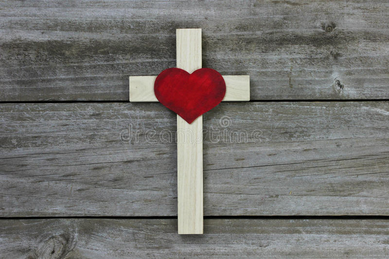 Download Wooden Cross With Red Heart On Rugged Wood Background Stock Photo