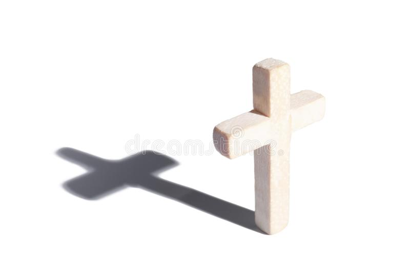 Wooden cross with shadow. On white background stock photography
