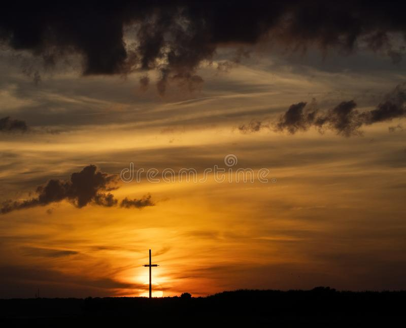Wooden Cross Silhouette at Sunset stock image