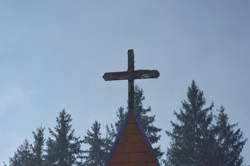 Wooden cross. On the sky with pines background stock photo
