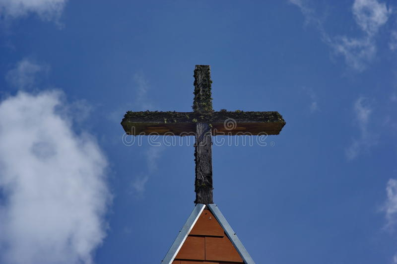 Wooden cross on the sky. With pines background royalty free stock images