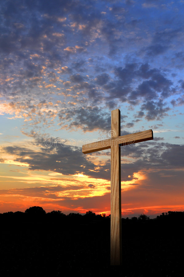 Wooden Cross and Sunset. Wooden cross during a beautiful sunset stock photo