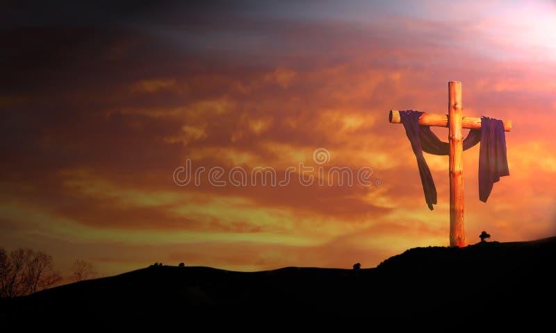 Wooden cross under sunrise stock photo