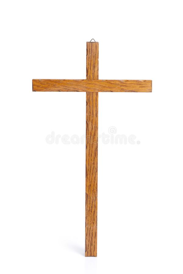Wooden cross on a white background. Wooden cross isolated on a white background stock image