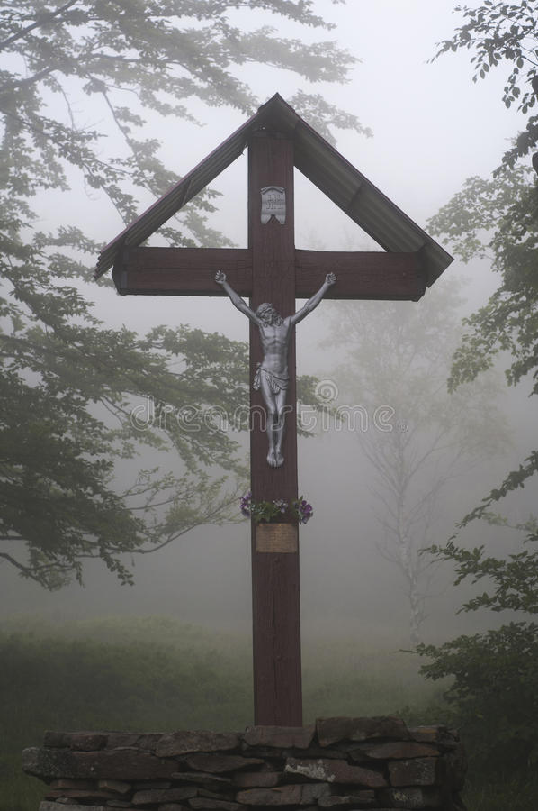 Wooden Crucifix in forest. Mountain in Poland royalty free stock photos