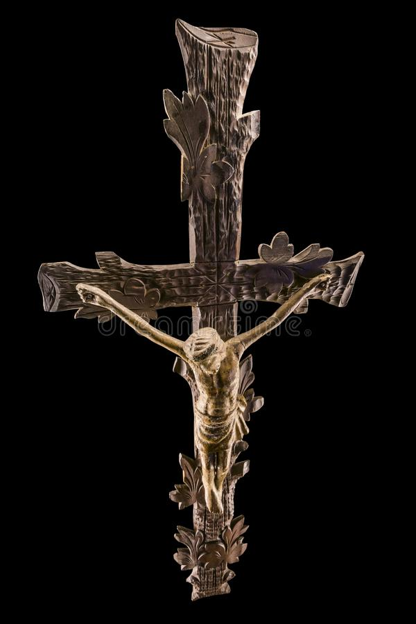 Wooden crucifix and magical light. Upper perspective on wooden crucifix magical light on a black background stock images