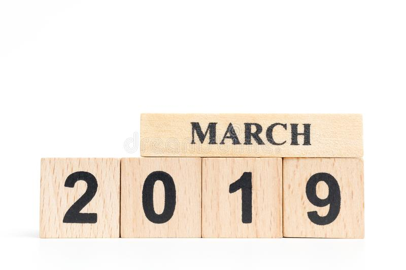 Wooden cube calendar MARCH 2019. Isolated on white background stock photos