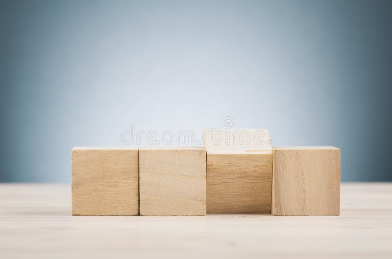 Wooden cube on desk over. Selective focus shot, image of wooden cube on desk over beautiful reverberation gradient background royalty free stock photos