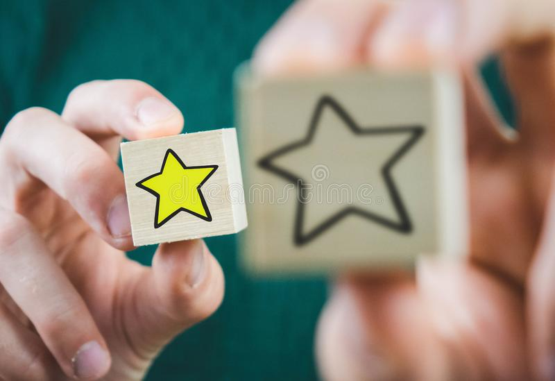 Wooden cube with a hot star in front, and with an extinct rear. Stars, background, business, design, abstract, hand, book, internet, technology, paper, best stock photography