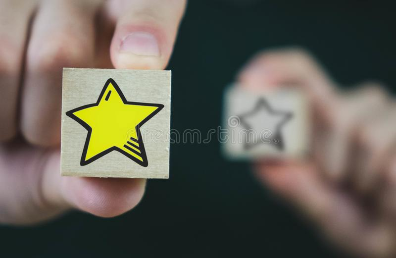 Wooden cube with a hot star in front, and with an extinct rear. Stars, background, business, design, abstract, hand, book, internet, technology, paper, best royalty free stock photo