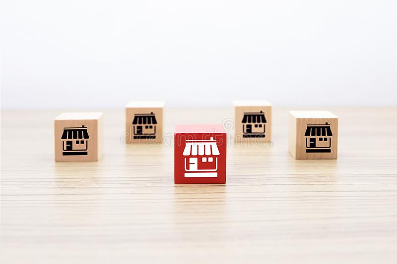 Wooden cube with Franchise business icons. Wooden cube with Franchise business marketing icons Store for business growth concept stock photo