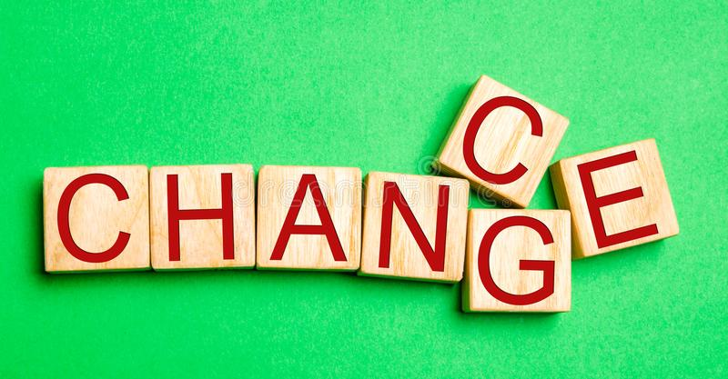 Wooden cube with word `change` to `chance` on wood table. Personal development and career growth or change yourself concept. conce stock photo