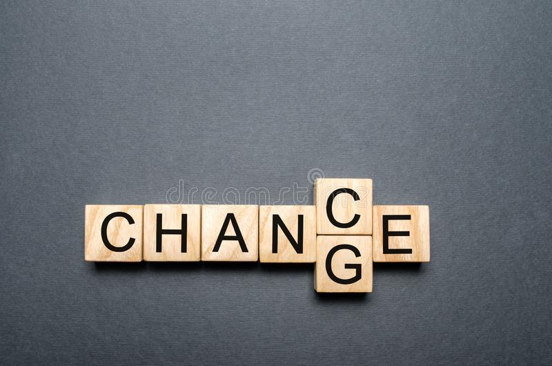 Wooden cube with word change to chance on wood table. Personal development and career growth or change yourself concept. concept stock image