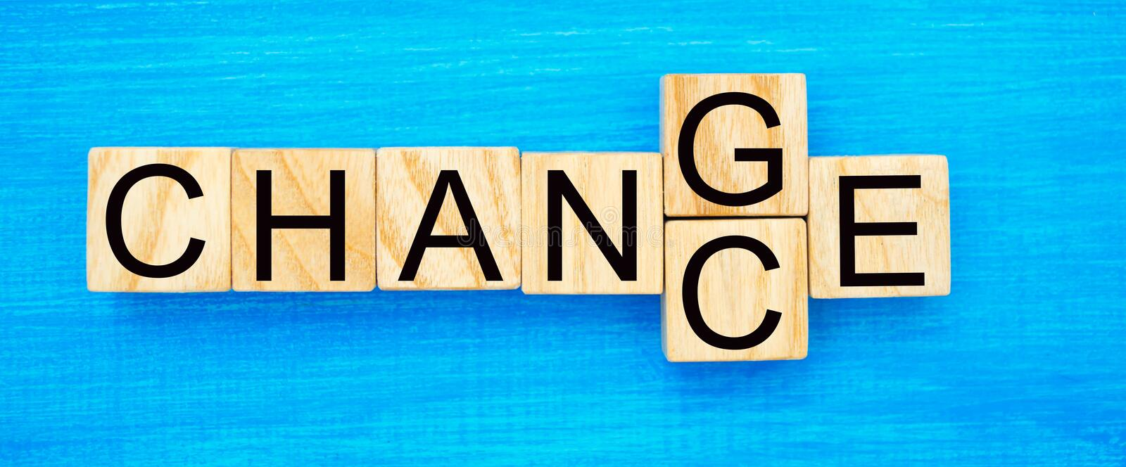 Wooden cube with word `change` to `chance` on wood table. Personal development and career growth or change yourself concept. conce royalty free stock image