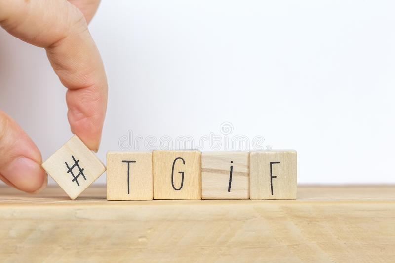 Wooden cubes with Hashtag and the word tgif, meaning Thank god its Friday, social media concept background. Close-up royalty free stock images