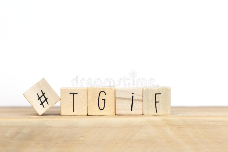 Wooden cubes with Hashtag and the word tgif, meaning Thank god its Friday, social media concept background. Close-up royalty free stock photography