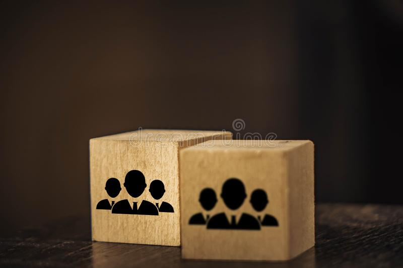 Wooden cubes image of staff on a black background. Human, resource, business, concept, employee, hr, job, manager, people, team, career, employment, leader stock image