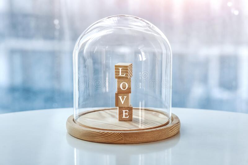 Wooden cubes with Love letters under glass cap. royalty free stock images