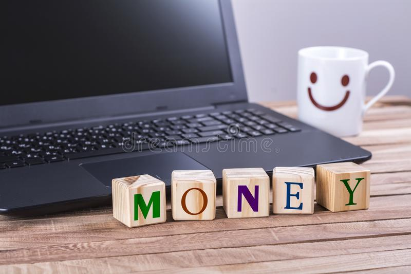Wooden cubes money word stock image