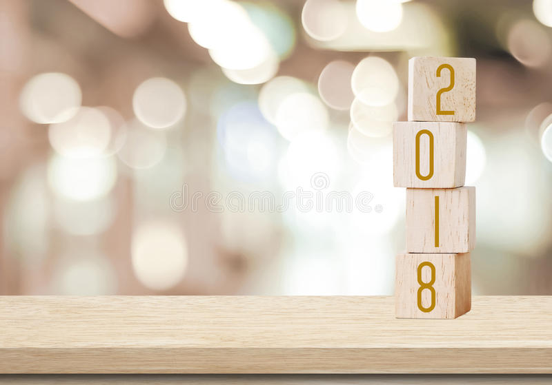 Wooden cubes with 2018 on perspective wood over blur bokeh background with copy space for text, new year template royalty free stock photos