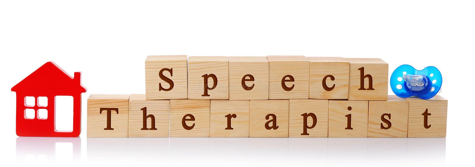 Wooden cubes with text Speech Therapist. On white background royalty free stock image